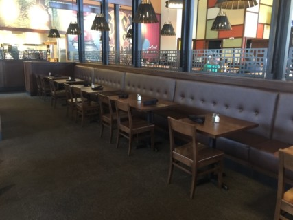<h5>Iron Hill Brewery and Restaurant</h5><p> Iron Hill Brewery and Restaurant - Dining Area Seating</p>