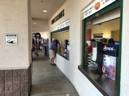 <h5>Concession stand near main entrance with lowered counter all the way around</h5>