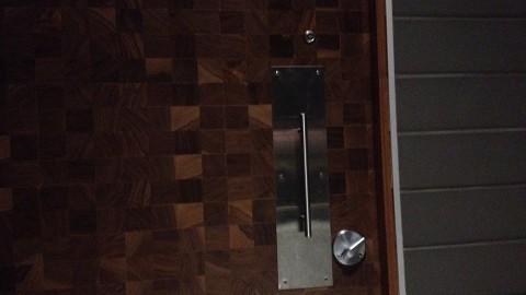 <h5>Pomo Pizzeria restroom door</h5>