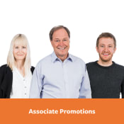 """Klaudia, Kenneth, and Travis pictured above banner that reads, """"Associate Promotions"""""""