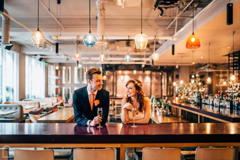 A couple drinks at The Anthologist, a modern wedding venue in the uk