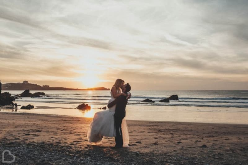 married couple kiss on Lusty Glaze Beach, a wedding venue in Cornwall