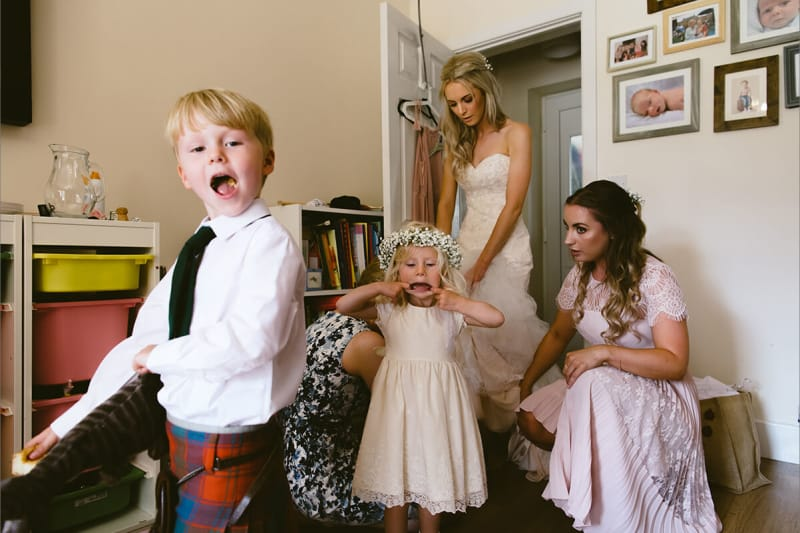 page boy and flower girl getting ready for a wedding. best wedding photos