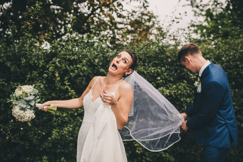 bride gets her veil caught in a bush