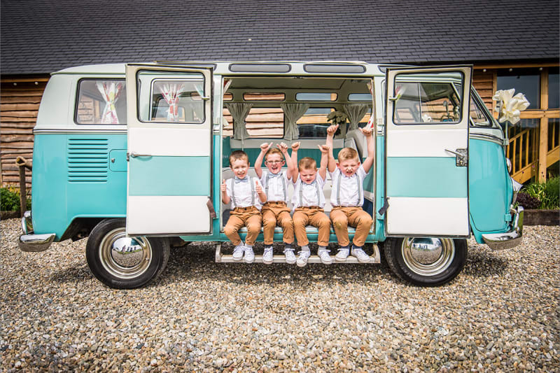 little page boys posing in a van