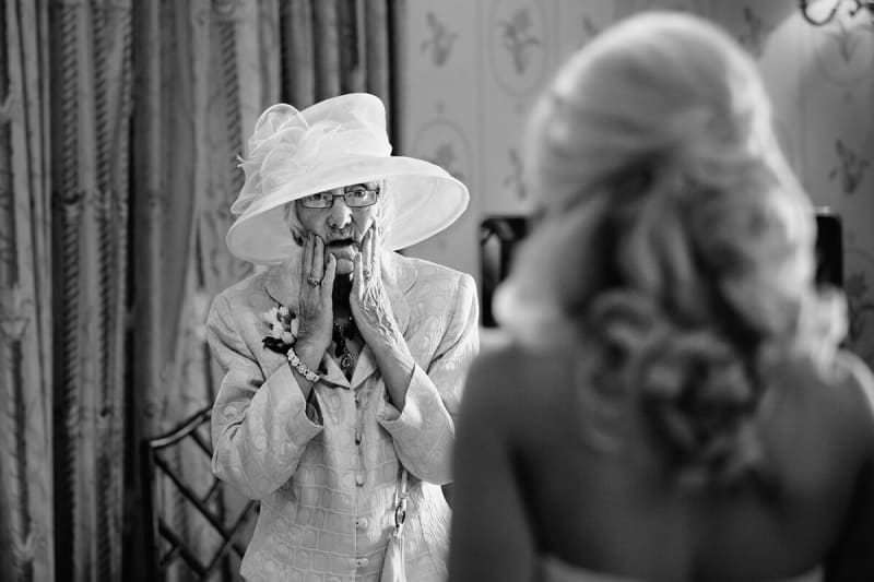 grandma look surprised when she sees the bride for the first time.