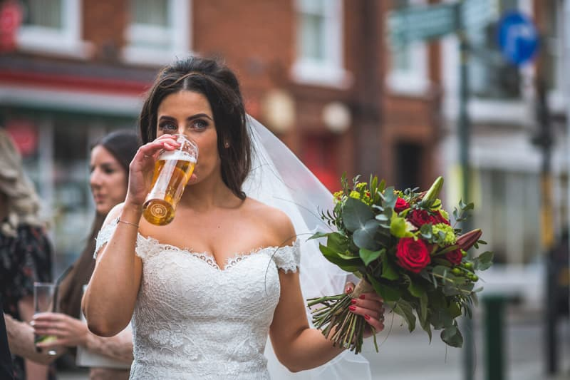 bride drinking a pint