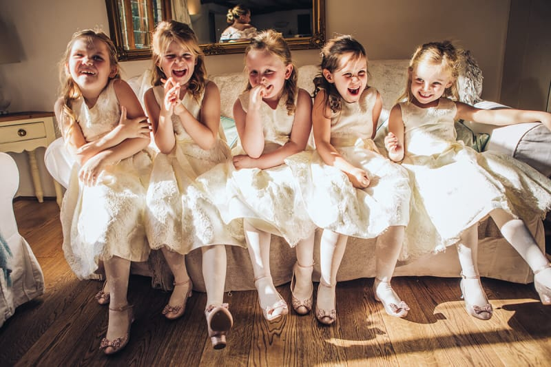 flower girls laughing at wedding