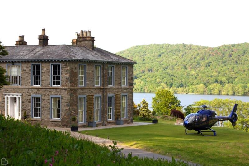 a helicopter is parked outside silverholme manor, a country house wedding venue in the uk
