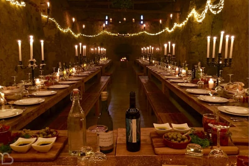 a candlelit table for many wedding guests in Eggbeer Farm, Devon