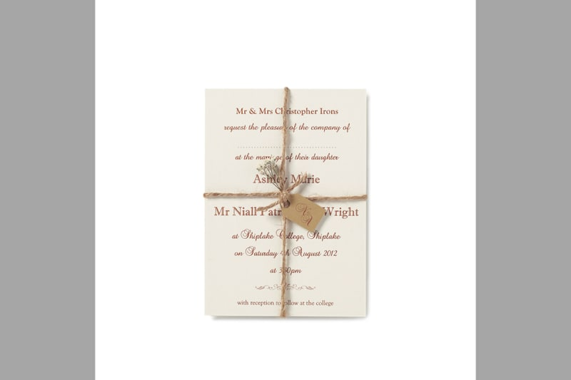 Bridebook.co.uk-Papteterie-Eugénie-wedding-inviation-wrapped-up-with-brown-string