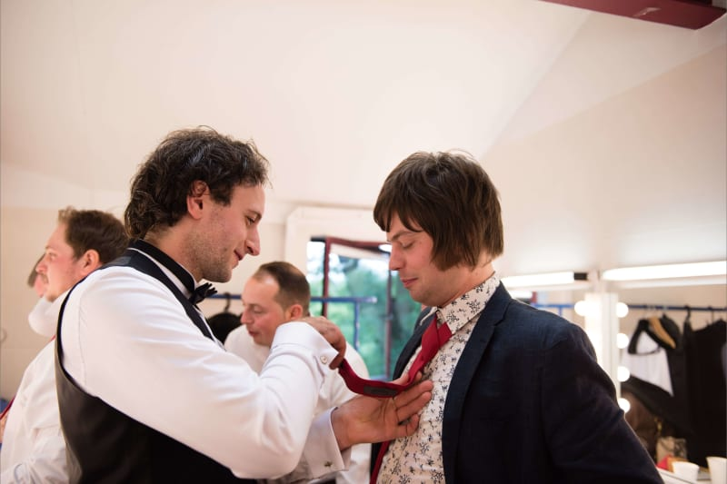 Bridebook.co.uk Groom fixing usher's tie