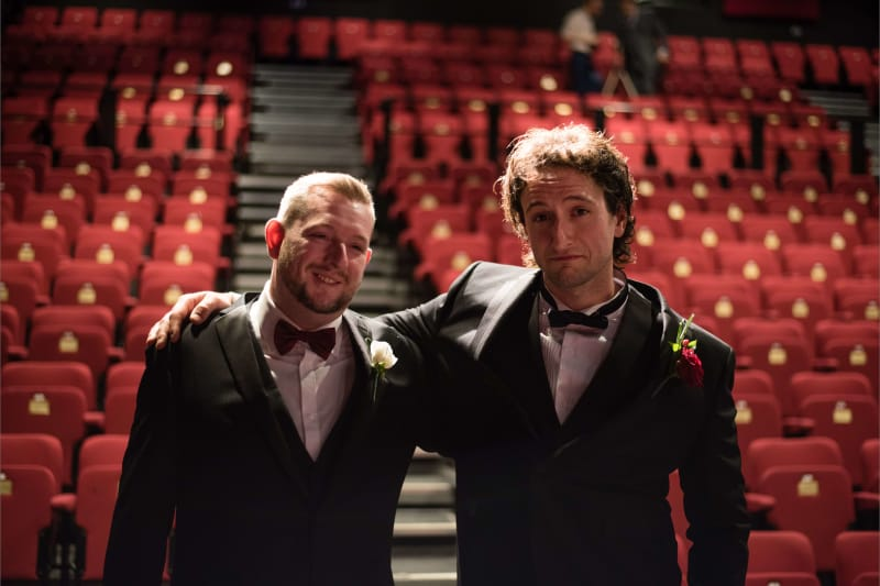 Bridebook.co.uk Groom and best man empty theatre