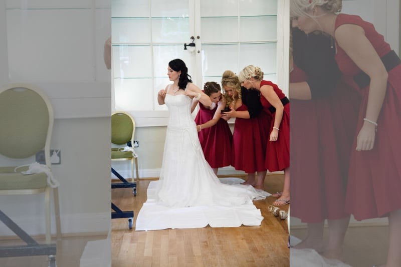 Bridebook.co.uk Bridesmaids taking photo of dress