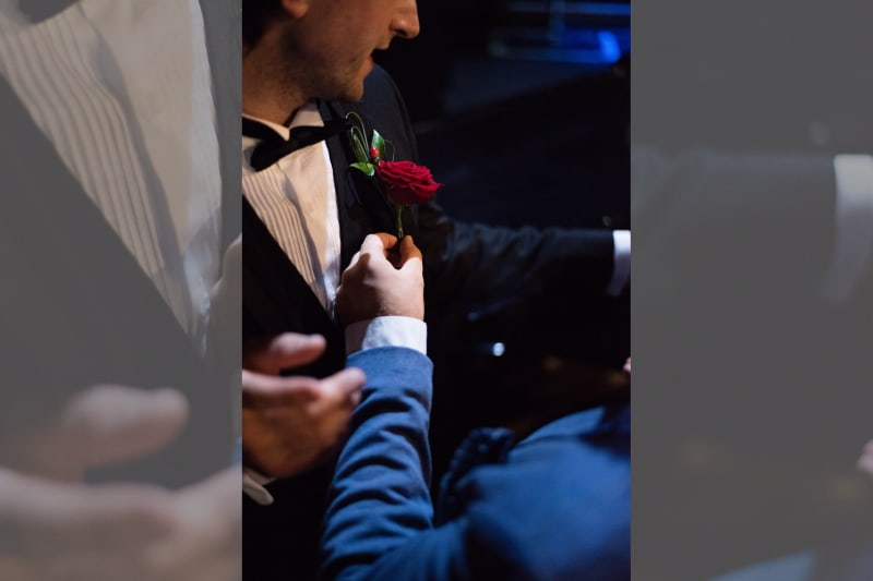 Bridebook.co.uk rose boutonniere on groom's tuxedo