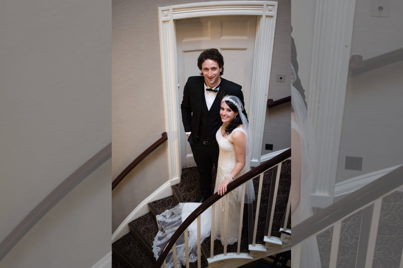 Bridebook.co.uk bride and groom on stairs