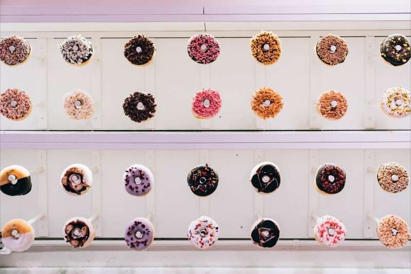 Doughnut wall holding plenty of  tasty doughnuts of different flavours at wedding