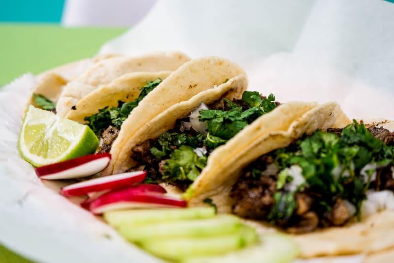 Delicious looking tacos served at tacos and nachos bar at wedding