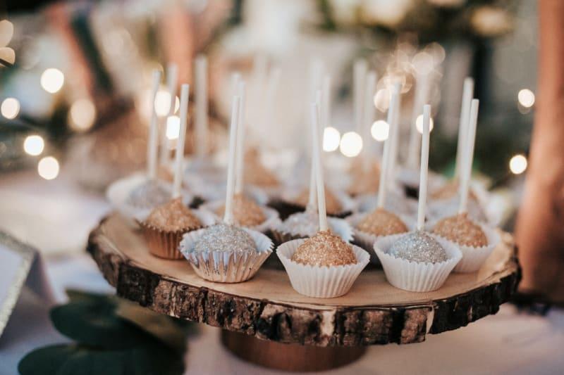 Cake pops being served at wedding