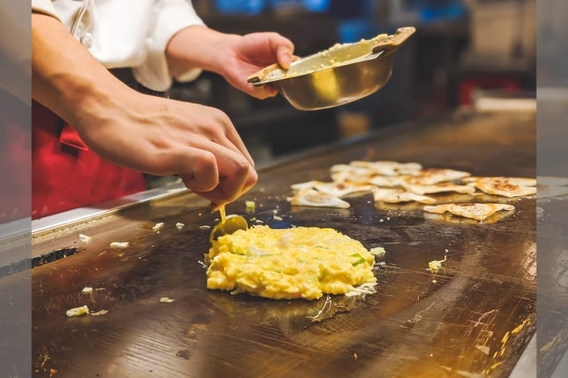 Omelette bar at wedding with person making delicious omelettes
