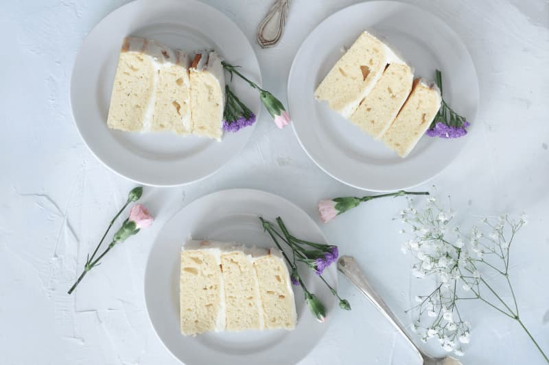 slices of sponge wedding cake with white frosting