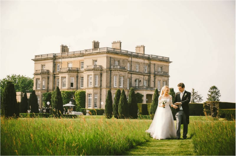 Hamish Shephard and newly wedded wife walking along the scenic grounds of a beautiful wedding venue