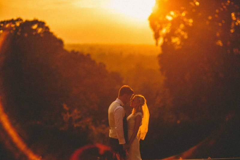 Bridebook.co.uk- bride and groom against the sunset