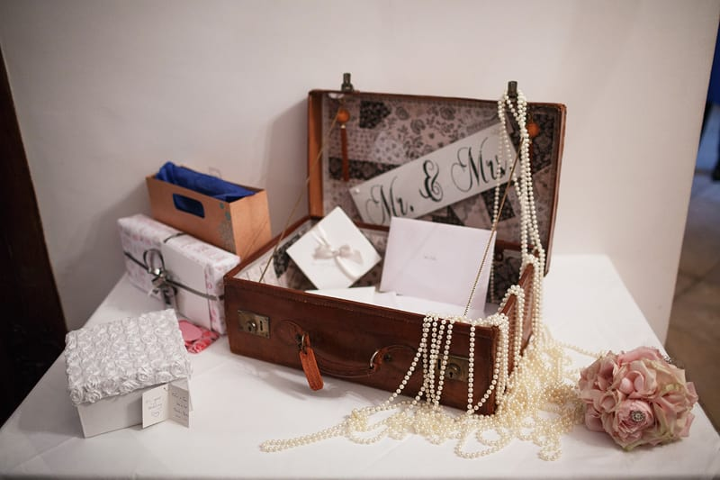 cards and gifts table with a suitcase
