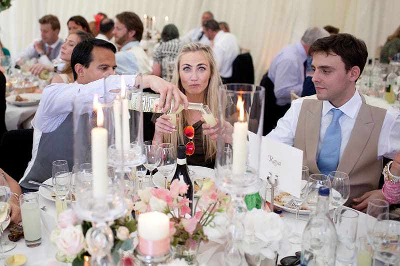 Bridebook.co.uk- guests pouring shots