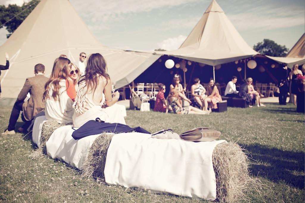 Bridebook.co.uk- guests sitting on hay bells