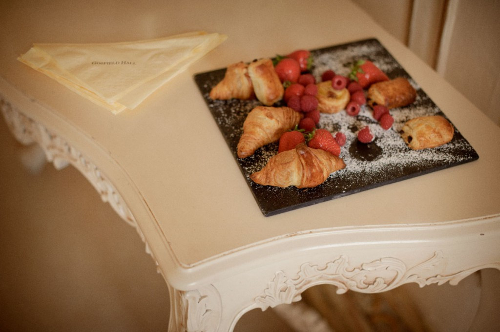 Bridebook.co.uk- croissants and strawberries laid out for wedding snack