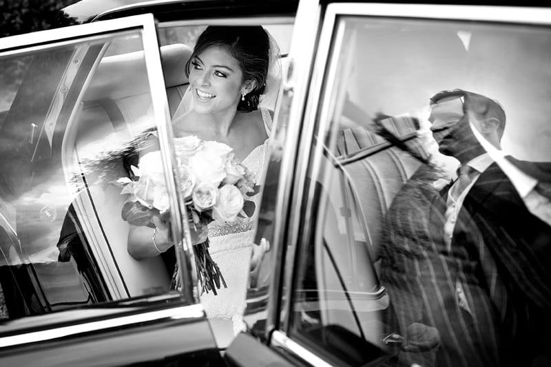 Bridebook.co.uk- bride arriving at ceremony in the car
