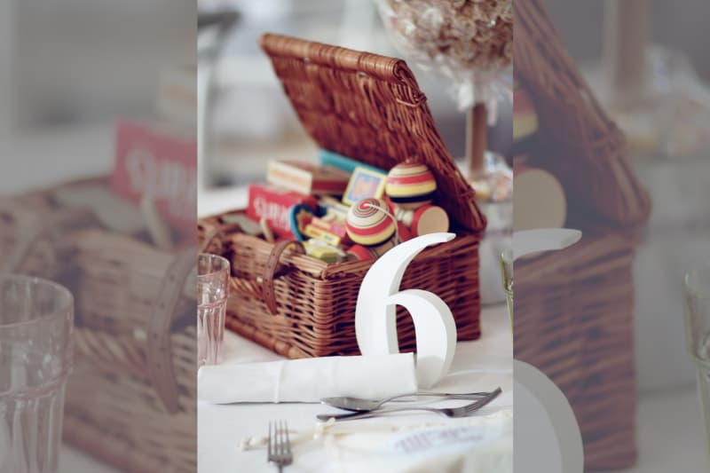 Bridebook.co.uk- wedding table number with old toys for decoration