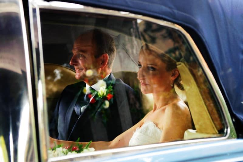 Bridebook.co.uk- bride and father in wedding car