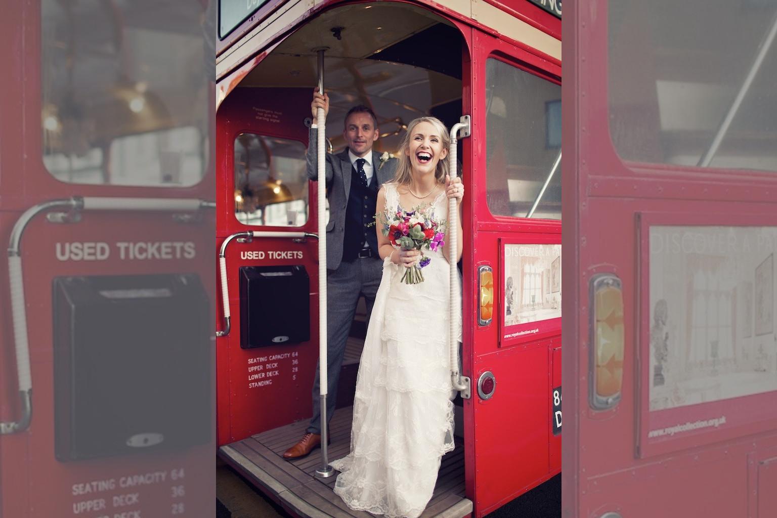 Bridebook.co.uk- bride and groom on board a red london bus
