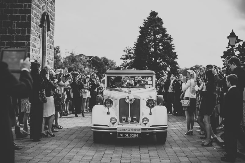 Bridebook.co.uk- bride and groom leaving ceremony in vintage car