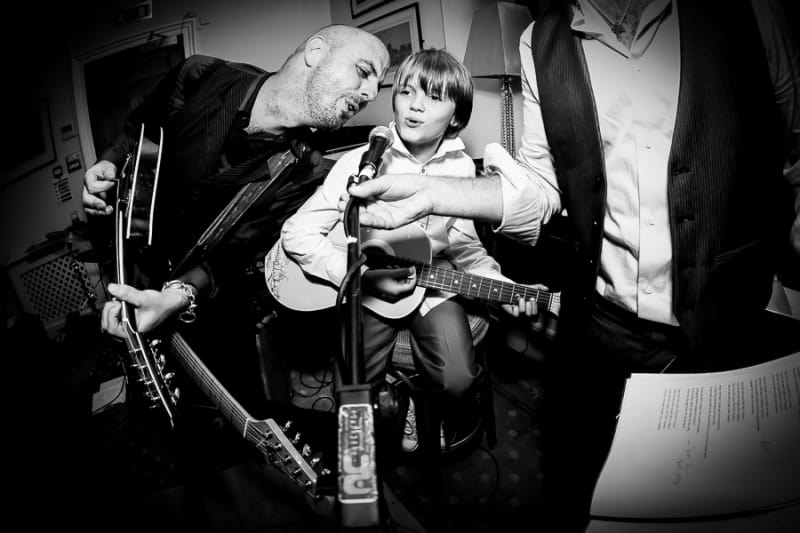 Bridebook.co.uk- wedding band performing as little boy sings along