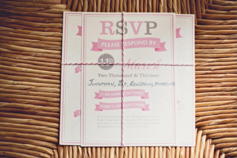 Bridebook.co.uk- pink wedding invitations tied over with pink string