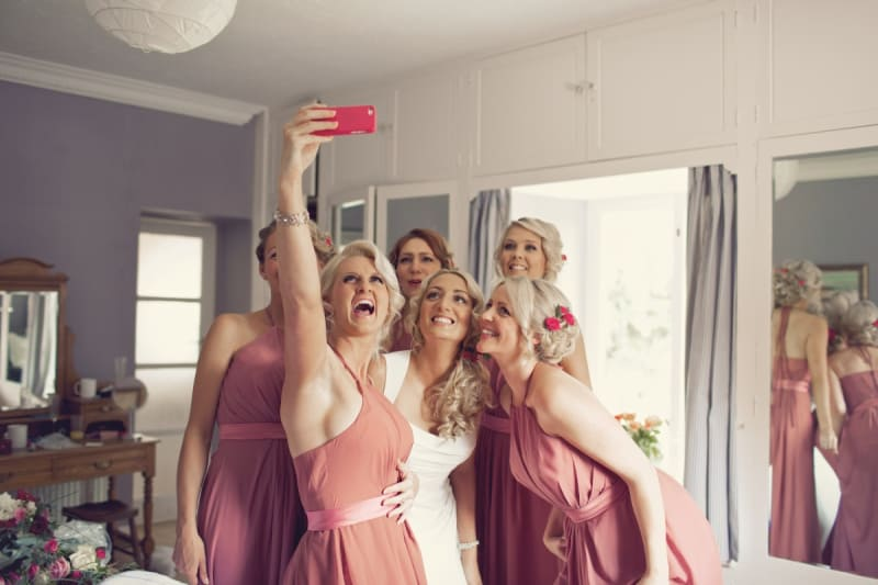 Bridebook.co.uk- bridesmaid taking a selfie with bride and bridesmaids
