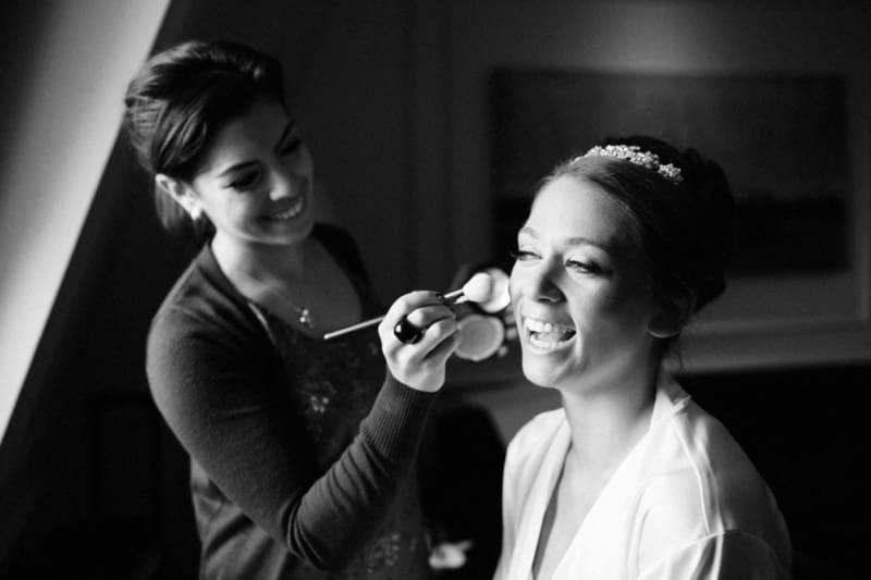 Bridebook.co.uk- bride and makeup artist laughing