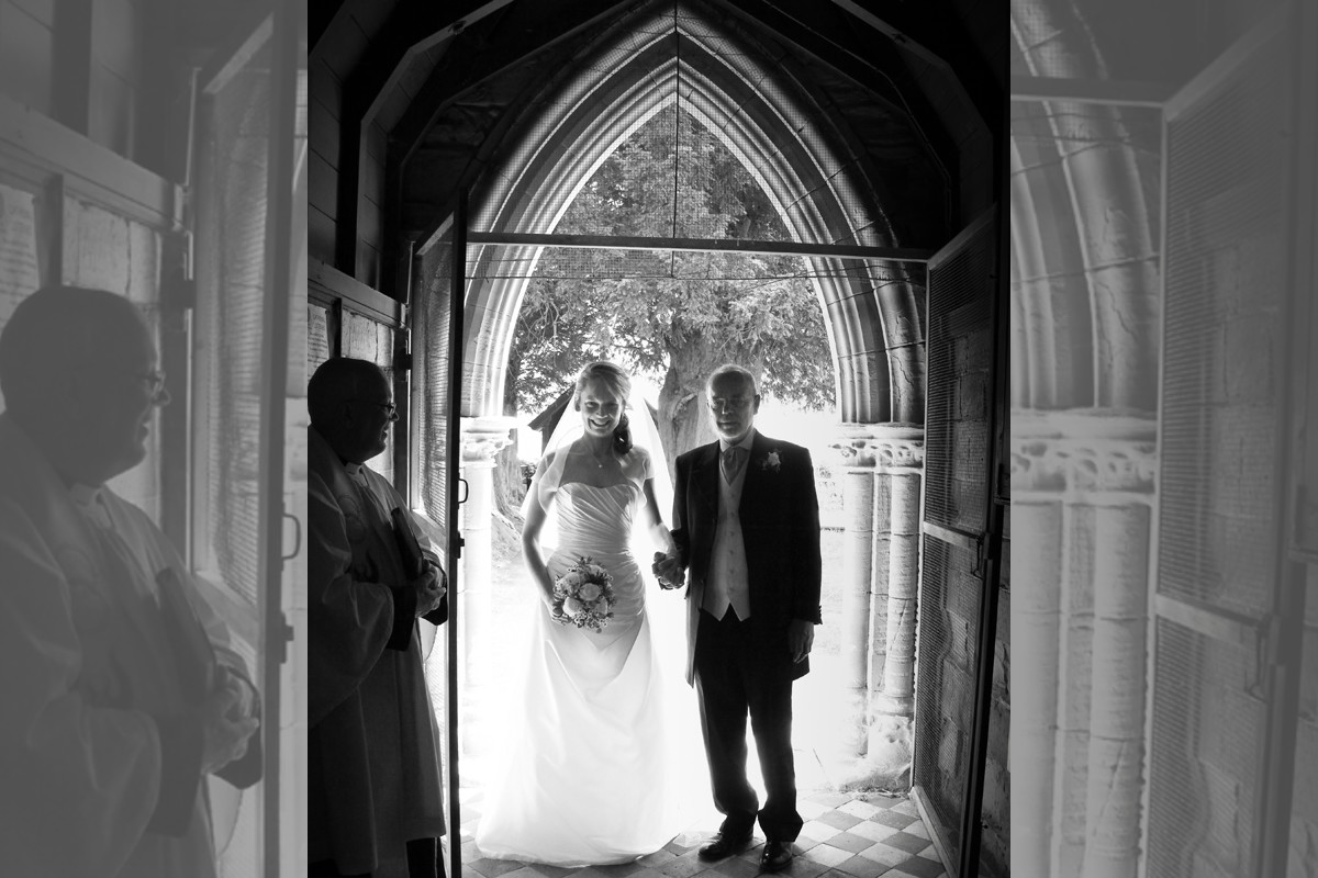Bridebook.co.uk- father walking into the church with the bride