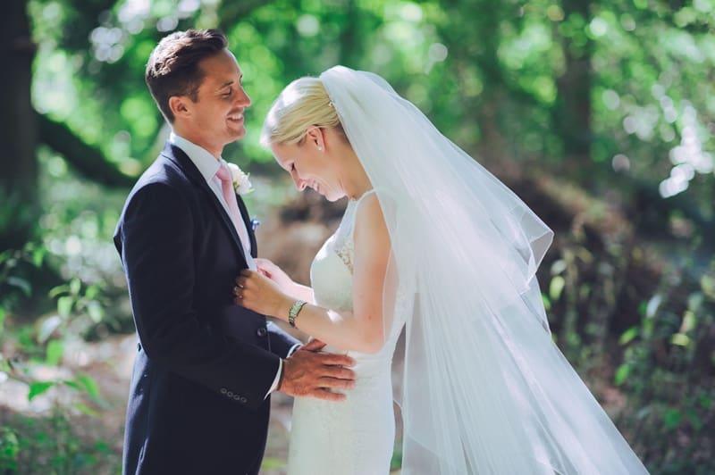 Bridebook.co.uk- bride and groom hug and smile