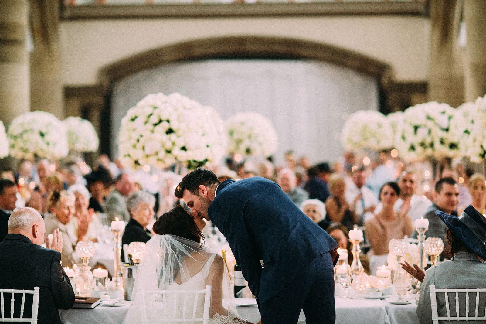 Bridebook.co.uk- kisses bride at reception
