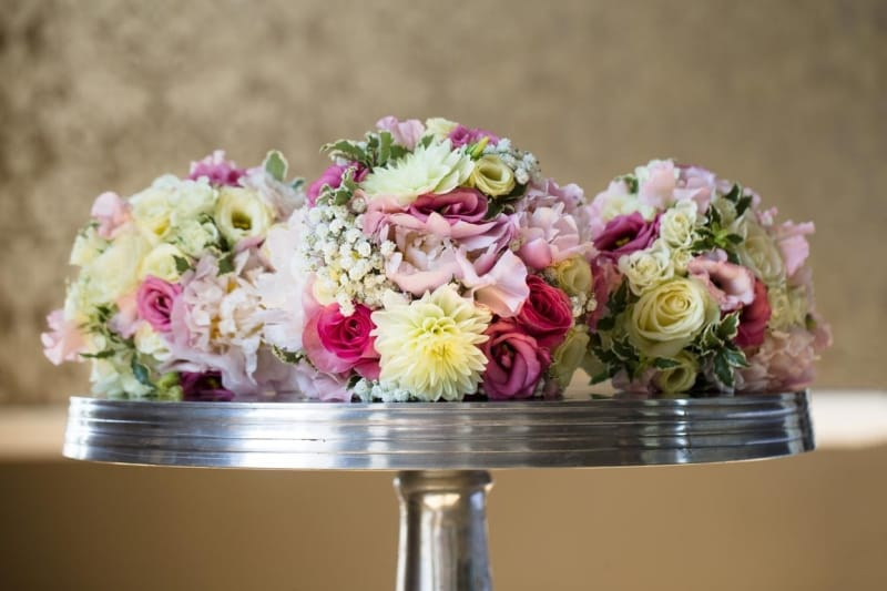 Bridebook.co.uk- wedding bouquets piled onto a table