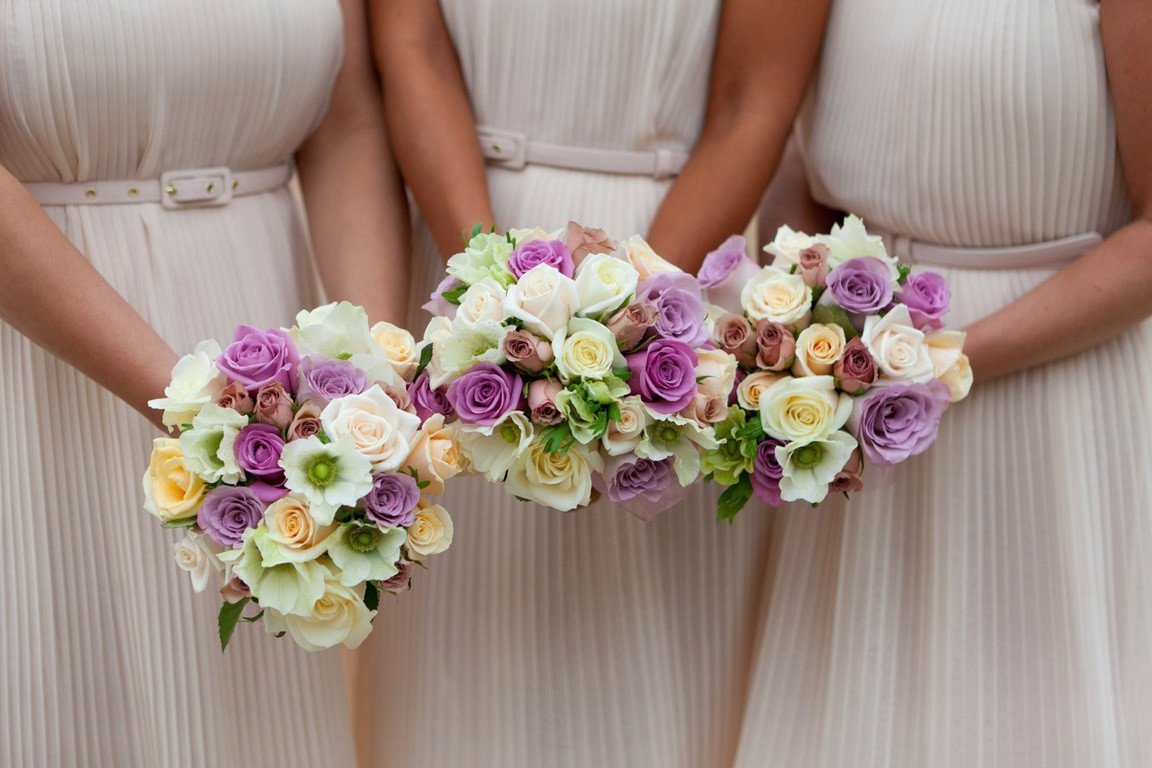 Bridebook.co.uk- bridesmaids holding up their wedding bouquets