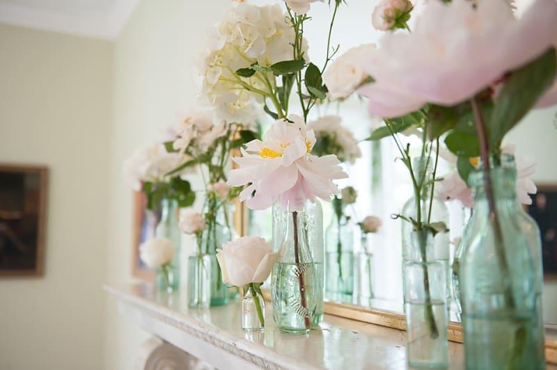 Bridebook.co.uk- wedding flowers on mantelpiece