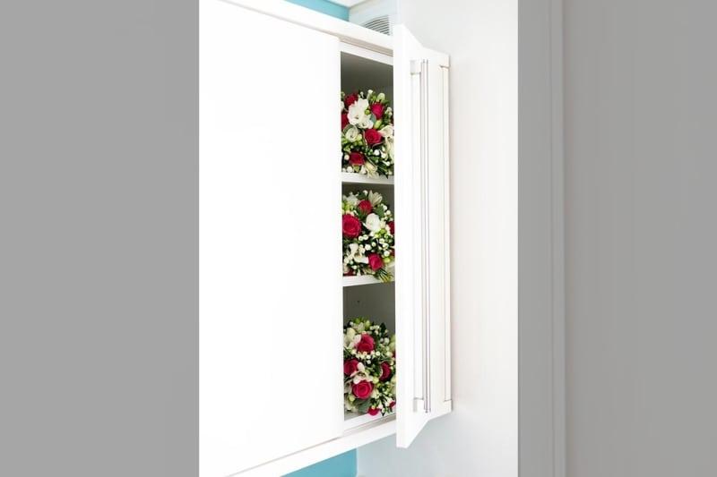 Bridebook.co.uk- wedding bouquets in cupboard