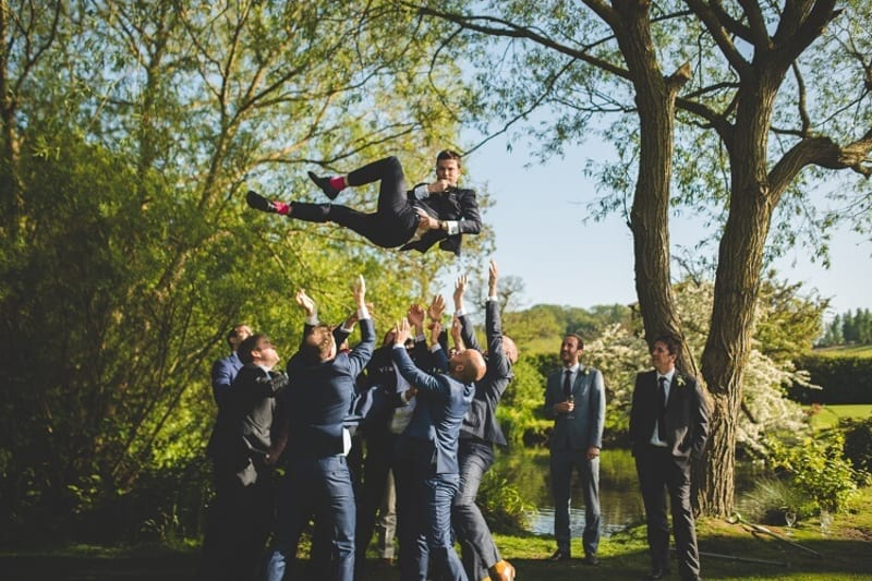 bridebook.co.uk groomsmen throw groom in the air