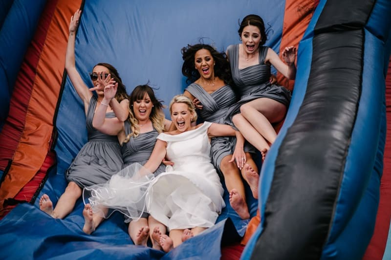 bridebook.co.uk bride and bridesmaids down the slide