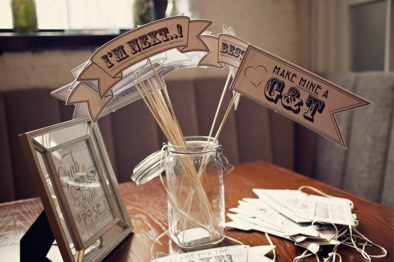 Bridebook.co.uk- flag props for ordering at the bar